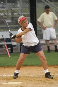 bigstock-Senior-woman-at-bat-in-softbal-26017139
